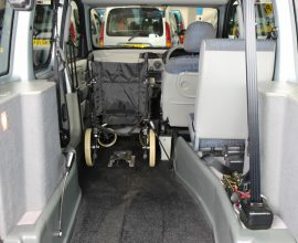 Kangoo wheelchair next to driver car