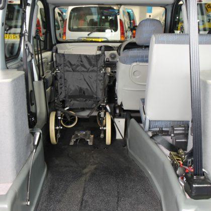 Kangoo wheelchair next to driver car