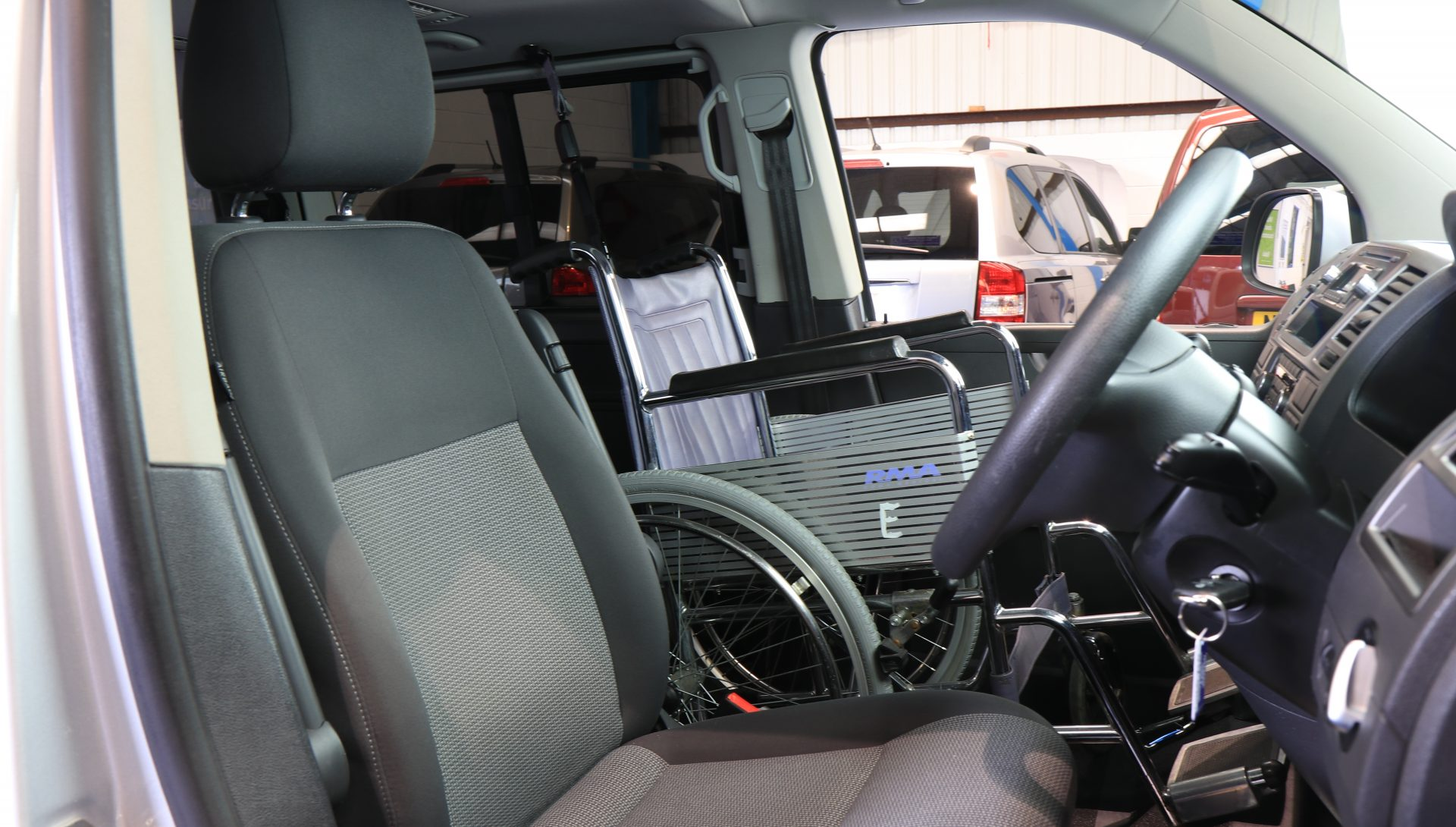 Transporter passenger upfront next to driver